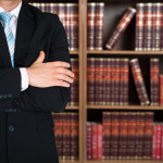 Midsection Of Lawyer With Arms Crossed
